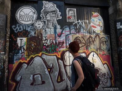 Nellie explaining the finer points of graffiti!