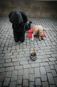 Beggar and his dog on Charles bridge, Prague