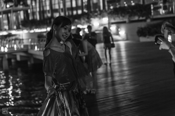 Singapore | Young tourists enjoying a night stroll on Marina Bay Sands waterfront
