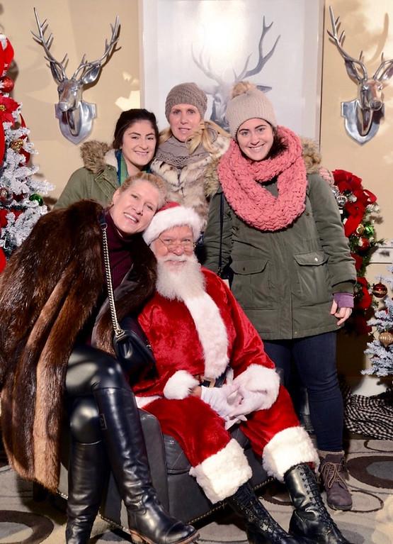 . Santa gets his treat � the zany Zouzas girls of Chelmsford