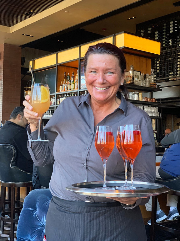 . Toni Colarullo of Medford, bartender at The Bancroft, serves up Signature champagne cocktails.