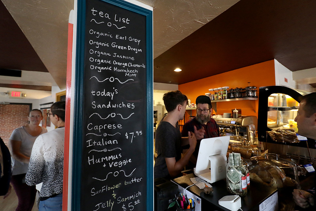 ". The new ""Strong Style Coffee\"" shop in Fitchburg held a ribbon cutting on Thursday, September 13, 2018. A list of just some of the things they serve at the shop. SENTINEL & ENTERPRISE/JOHN LOVE"