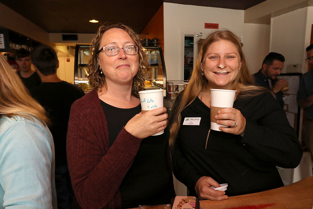 ". The new ""Strong Style Coffee\"" shop in Fitchburg held a ribbon cutting on Thursday, September 13, 2018. Having some coffee at the ribbon cutting is NewVue employees Laurel Miller and Lisa Gonzalez. SENTINEL & ENTERPRISE/JOHN LOVE"