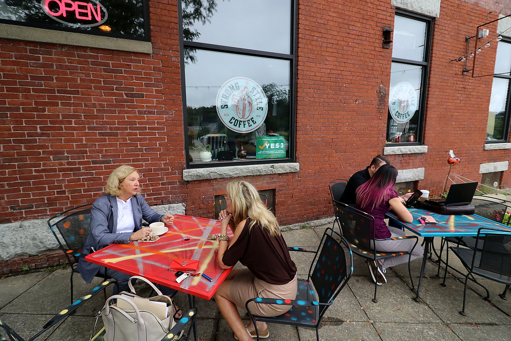". The new ""Strong Style Coffee\"" shop in Fitchburg held a ribbon cutting on Thursday, September 13, 2018. They have an outdoor sitting area for customers. SENTINEL & ENTERPRISE/JOHN LOVE"