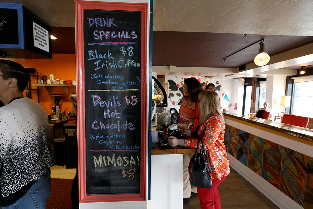 ". The new ""Strong Style Coffee\"" shop in Fitchburg held a ribbon cutting on Thursday, September 13, 2018. A list of some of the drink specials. SENTINEL & ENTERPRISE/JOHN LOVE"