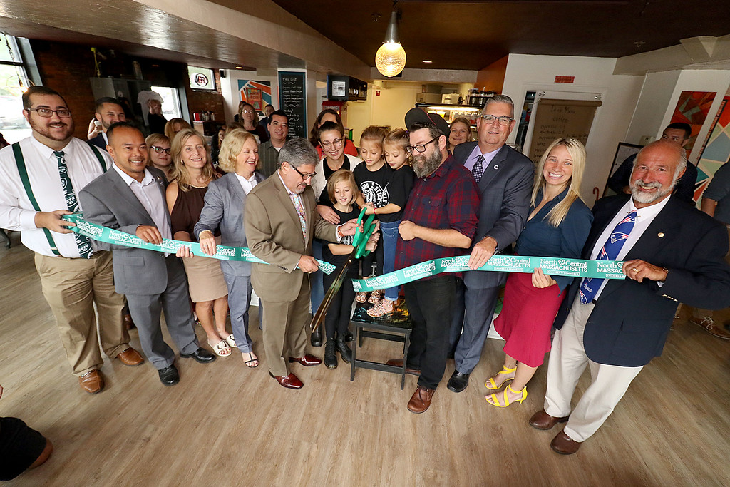 ". The new ""Strong Style Coffee\"" shop in Fitchburg held a ribbon cutting on Thursday, September 13, 2018. From left is North Central Massachusetts Chamber of Commerce\'s Member Services Associate David Ginisi, State Senator Dean Tran, Councilors Marisa Fleming, BethWalsh, Fitchburg Mayor Stephen Dinatale, owner Kim Jones with her kids Evelyn, 9, Nola, 6, Anna, 6, owner Eirean Bradley, State Rep. Stephan HAy, councilor Sam Squailia and Ray Belanger the director of samm business for NewVue. SENTINEL & ENTERPRISE/JOHN LOVE"