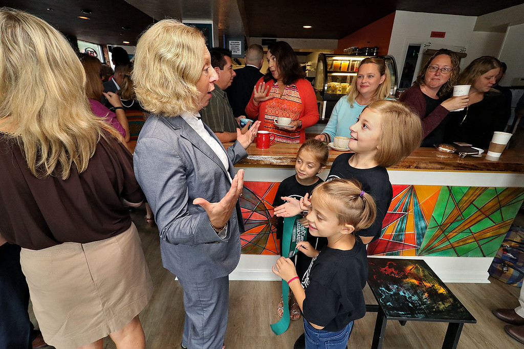 ". The new ""Strong Style Coffee\"" shop in Fitchburg held a ribbon cutting on Thursday, September 13, 2018. Fitchburg City Councilor Beth Walsh chats with her great nieces Nola, 6, Evelyn, 9, and Anna Jones , 6, the children of owner Kim Jones after the ribbon cutting. SENTINEL & ENTERPRISE/JOHN LOVE"