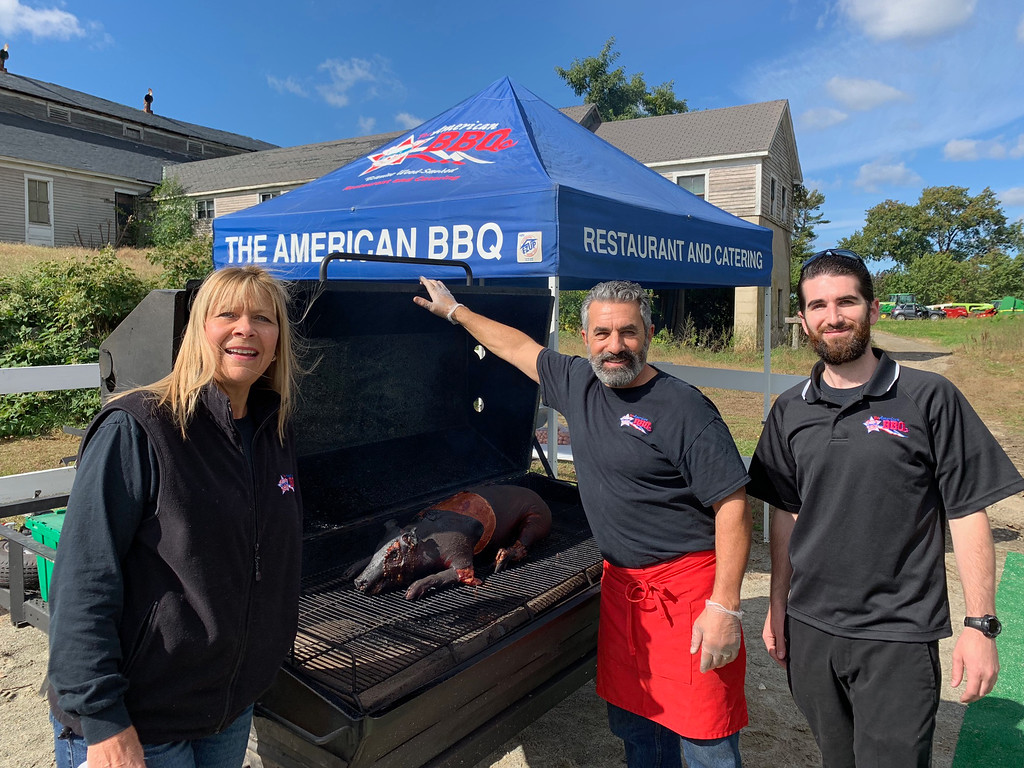 . The American BBQ team holds a pig roast to make smoked BBQ pulled pork.