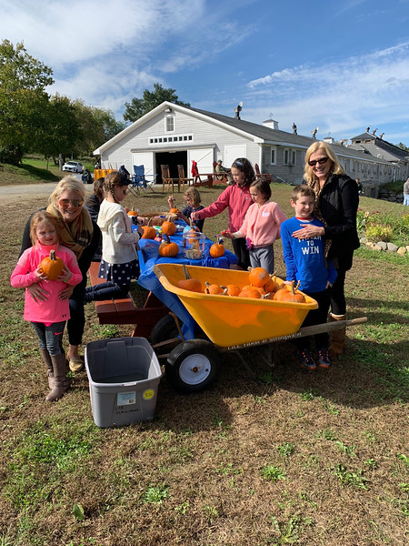 Cowboys and girls pick out pumpkins to paint.