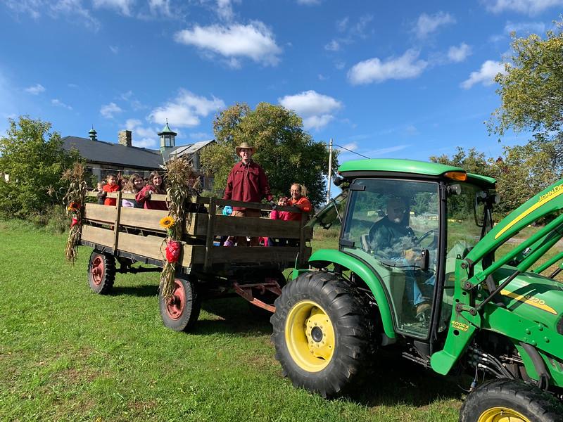 Folks enjoy a hay ride.