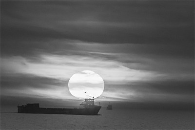 Cargo Ship and Setting Sun in North Sea