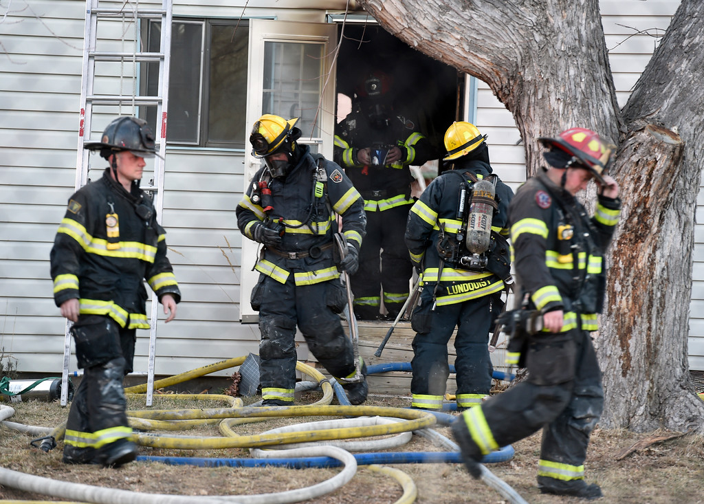 . Firefighters work to put out a structure fire on Modred Street on Wednesday in Lafayette. For more photos of the firefighters working the scene go to www.dailycamera.com Jeremy Papasso/ Staff Photographer/ Feb. 15, 2017