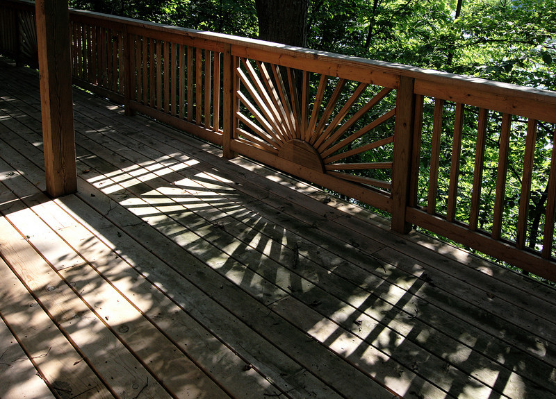 Sunset shadows on back deck<br /> <br /> Crooked Lake, SE Michigan
