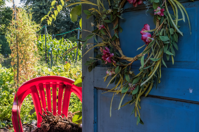 Blue garden door and red chair - v.2, landscape format