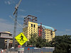 Colors of summer:  Constructions sites and warning signs.<br /> The actual building is map tagged.  The view is to the northwest from a site on Ingalls Mall.<br /> <br /> July, 2009