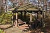 D309-2012 A shelter in the Shade Garden section.  But now that all the leaves are off the trees, sunlight invades it in late afternoon.<br /> .<br /> Toledo Botanical Garden, Ohio<br /> November 5, 2012