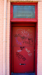 Grafitti on a door.  Long Island City, NY.  30 Mar 2008