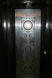 Door in an apartment building. Queens, NY.  30 Mar 2008