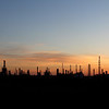 Silhouettes of Power Lines and Oil Refinery