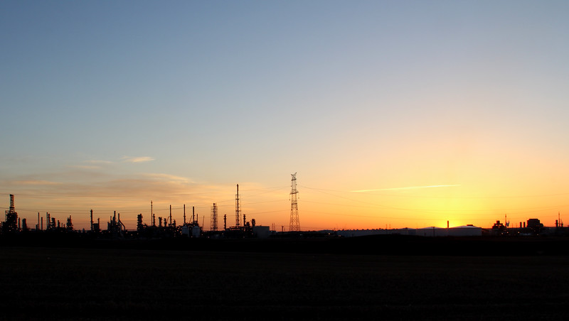 Oil Refinery and Powerlines at Sunset