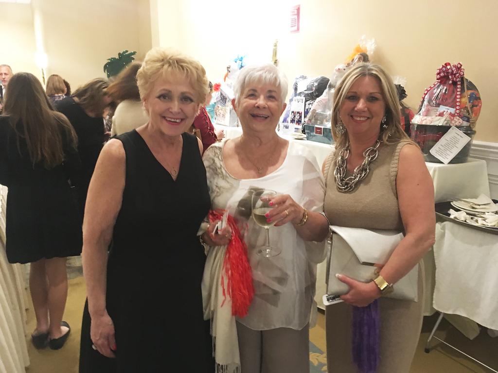 . From left, cancer survivor and model Brenda Deschense of Hudson, and Barbara and Susan Ferchak of Dracut