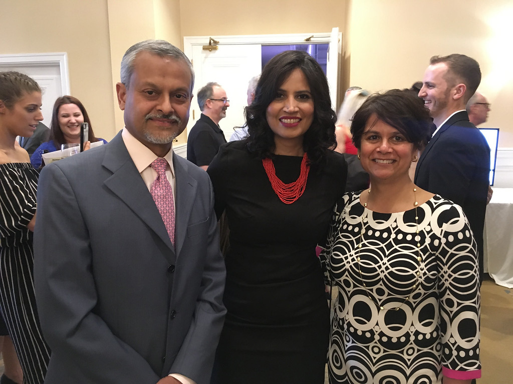 . At center, model and Dr. Anasuya Gunturi of Newton, with Dr. Atul Bhat, left, and Dr. Ajita Bhat, both of Andover
