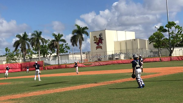 Tristan Pitching against Pompano Beach HS- come-backer for an out