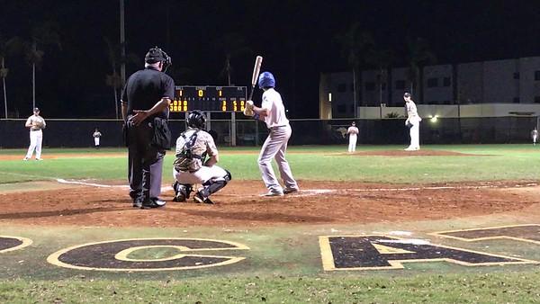 Tristan batting against Western Highschool- bunt