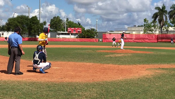 Tristan Pitching against Pompano Beach HS- K swinging on 1-2 count high heat