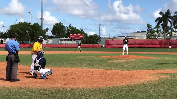 Tristan Pitching against Pompano Beach HS- K swinging