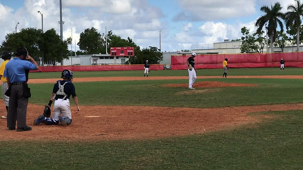 Tristan Pitching against Pompano Beach HS- K swinging on 1-2 count
