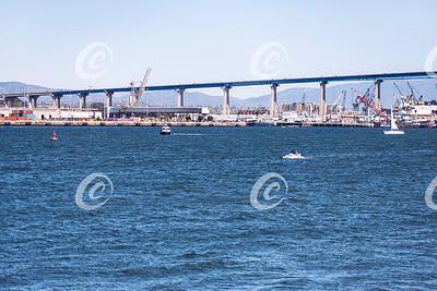 The Coronado Island to San Diego Bridge and the Shipyards Underneath with Boats on the San Diego Bay