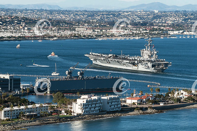 Aircraft Carrier and Sailboats in San Diego Bay in California