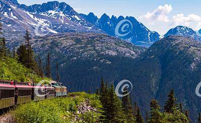 A Narrow Gauge Tour Train Hugs the Mountainside near Skagway Alaska