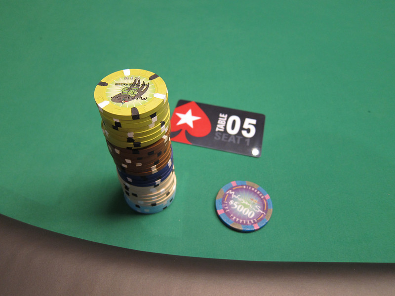 Here's what I had to work with at the beginning.  The stack on the left is made of tournament chips.  The pink and blue chip on the right is worth $5000 in real money.