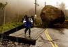 A boulder some 25 feet high blocks the Topanga Canyon Road Monday, Jan. 10, 2005, as workers repair power lines in Malibu, Calif. No injures were reported, but the road remains closed. (AP Photo/Damian Dovarganes)