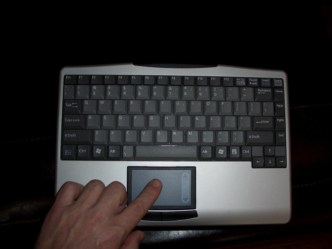 The touch pad functions as a mouse, much like you might find on a laptop.  Nice clickey-action on the keys too.