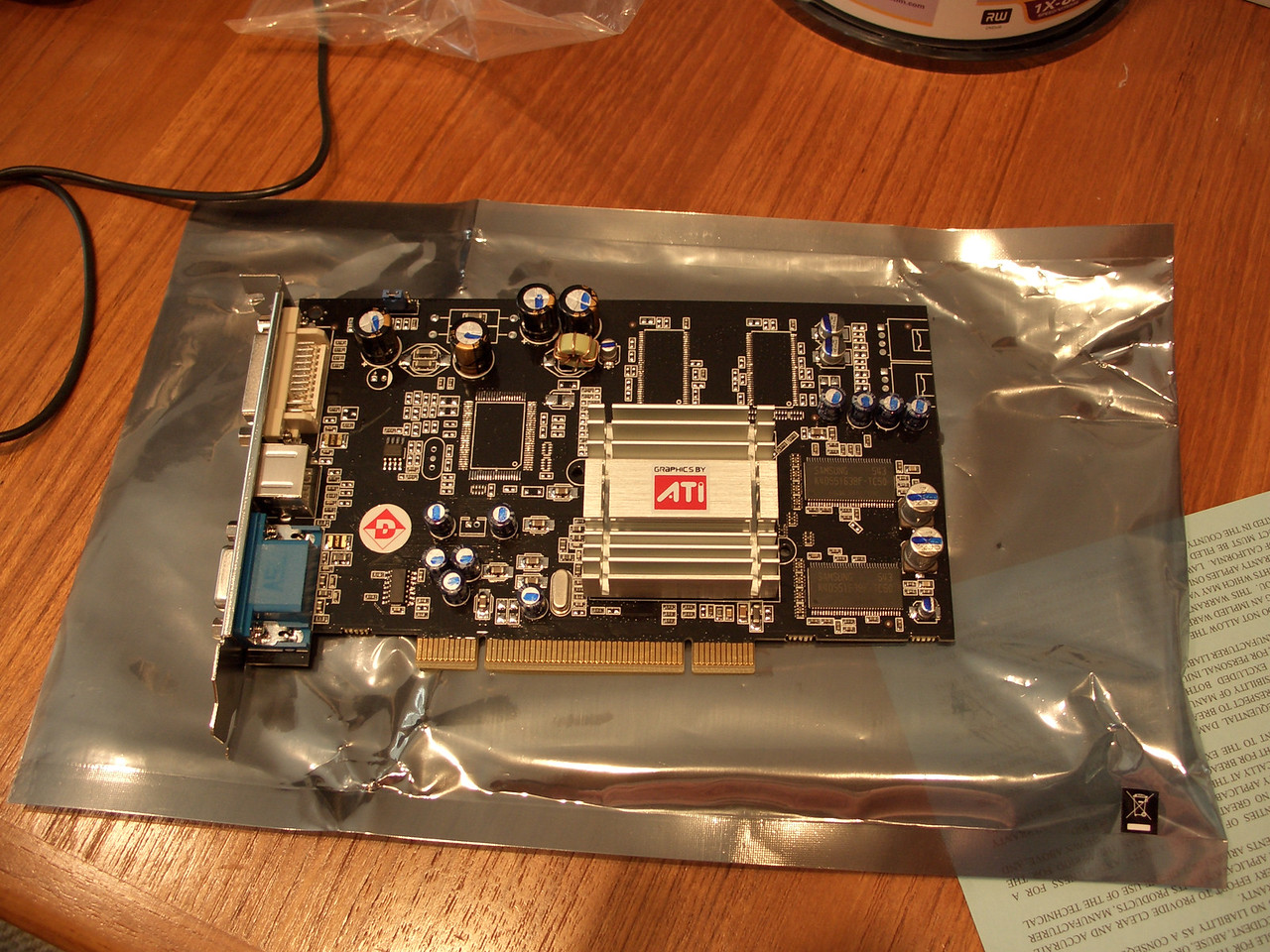 I couldn't help myself with this item.  The additional $70 for a better video card seemed worth it.  I specifically shopped models with no fans.  This Radeon 9250 holds 128MB video RAM and is PCI.  I was happy to have the DVI-out as well.   In retrospect, the motherboard on the ACER has an AGP slot, which would have been a better option.  Unfortunately, there wasn't a shred of info to that regard in the 'technical specs.'