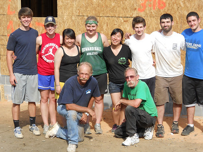 Charlie Thell (kneeling, left) and Tim DuBois pose with their Notre Dame work crew. From left: Alexander Hathaway, Claire Kozlowski, Linh Chi Phan, Amelia Vojt, Michele Paek, Kevin Miller, Barton Dear and Nolan Reed.