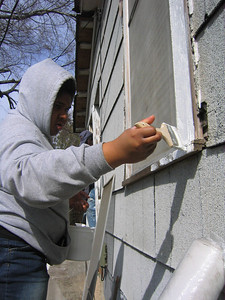 08 02 Student painting trim around window of Hamm renovation in Conyers, GA  lf