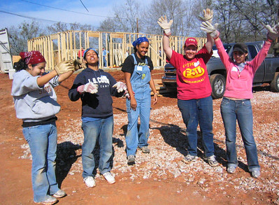 08 03-10 FSU women give collegiate cheer at 3-house build in Lanett. lf