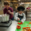 Marianna Umpierrez of Longsjo MIddle School cuts up some red peppers as  her helper Donna Landry adjusts the heat on a gas stove as they prepare ingredients for Marianna's Stew at the 2017 Future Chefs Competition at  Fitchburg High School. SENTINEL&ENTERPRISE/ Jim Marabello