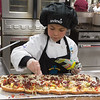 Kianna Payton, winner of the 2017 Future Chefs Competition finishes off her Whole Wheat French Toast Breakfast PIzza. SENTINEL&ENTERPRISE/ Jim Marabello