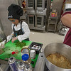 Mash'al Wagar works on her Meatball Sliders during the 2017 Future Chef Competition at Fitchburg High School. SENTINEL&ENTERPRISE/ Jim Marabello