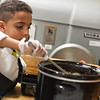 Asa Oywech of South St Elementary works o his Chicken Chili at the 2017 Future Chefs Competition at  Fitchburg High School. SENTINEL&ENTERPRISE/ Jim Marabello