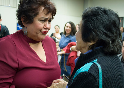 A woman (left) is in tears as she shakes Dolores Huerta's hand, thanking her for what she's done on behalf of the Latino community.