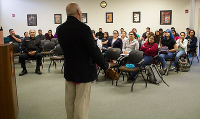 The audience in the Levan Center listens to Jimmy Santiago Baca speak.
