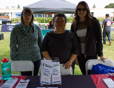 Representatives from Greater Bakersfield Legal Assistance host a booth during the Renegade Pulse Health Fair.