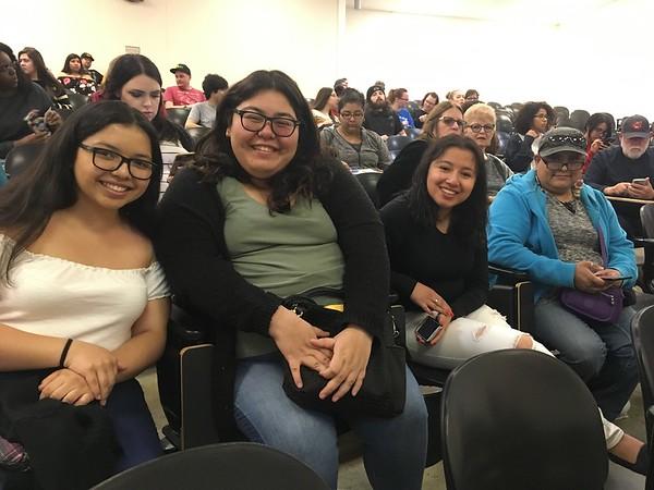 Audience members smiling.