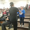 Staff handing something to an audience member.